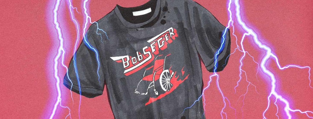 A Bob Seger concert tee with a wheelchair on it is prominently featured with lightning bolts striking around it.