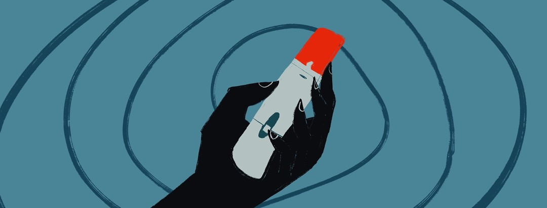person holding humira injection