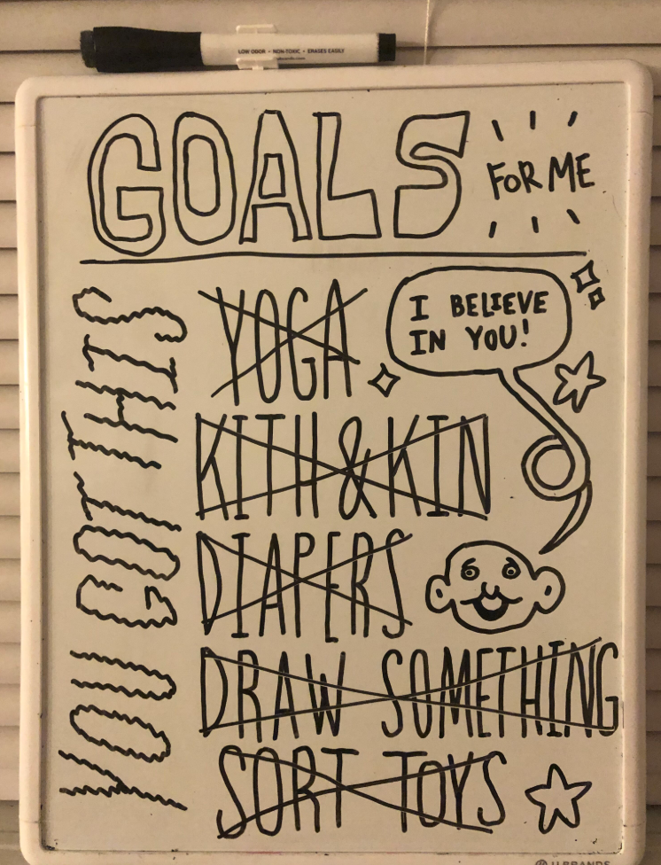 A to do list written on dry erase board