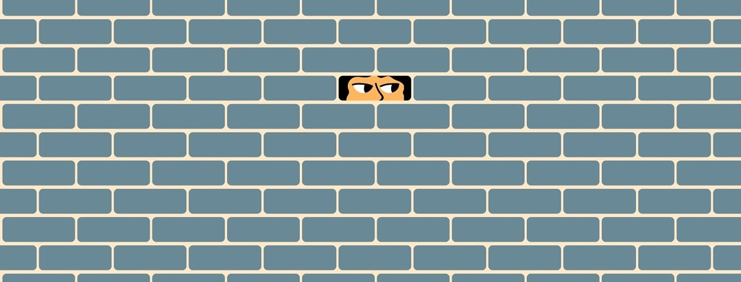 Person looking through hole in wall.