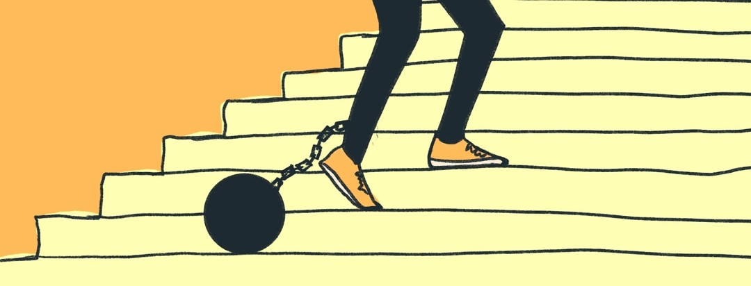 person walking up stairs with ball and chain attached to their leg