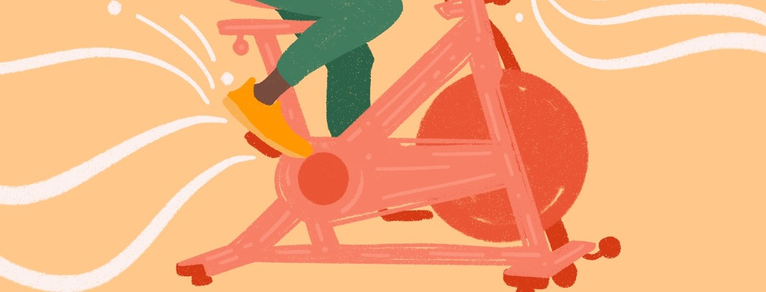 Person on indoor stationary exercise bike with swirls of movement