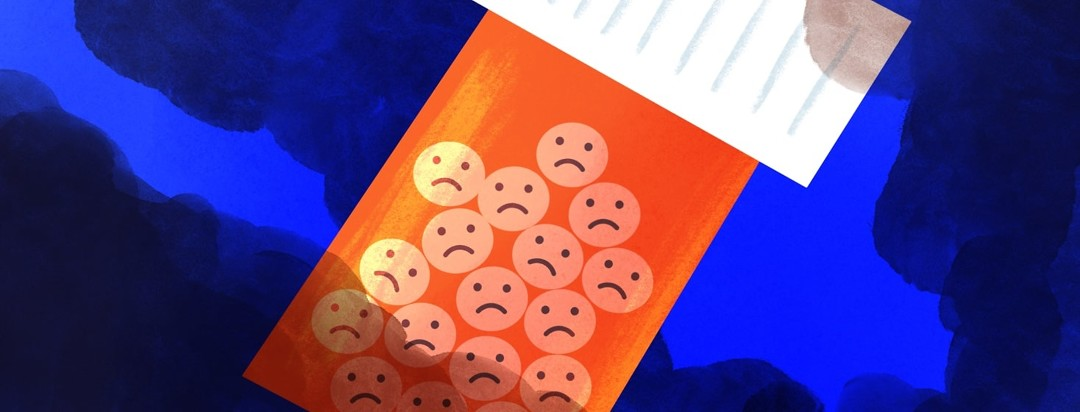 pill bottle containing pills with sad faces