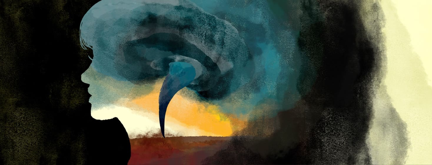 inside the silhouette of a woman's profile is a swirling tornado.